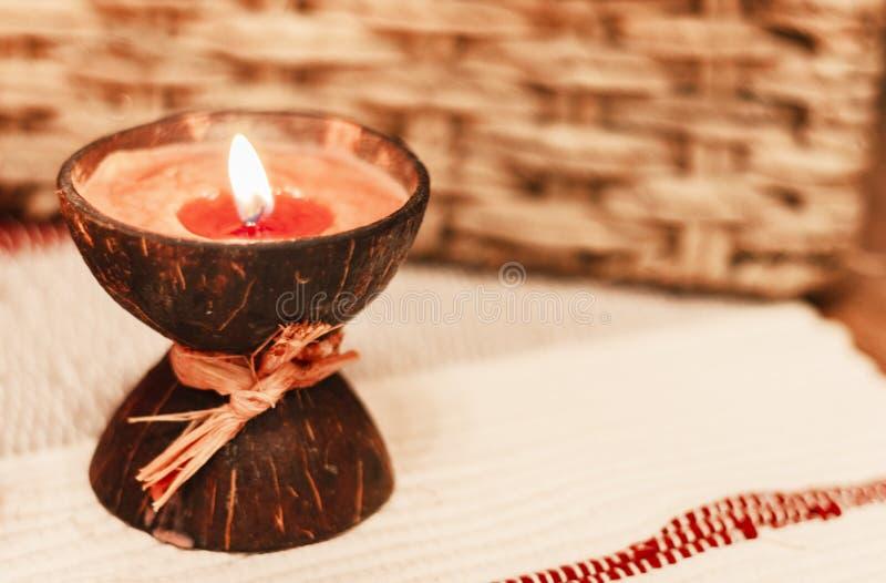 Cozy home interior decor, burning candle - Image royalty free stock photo