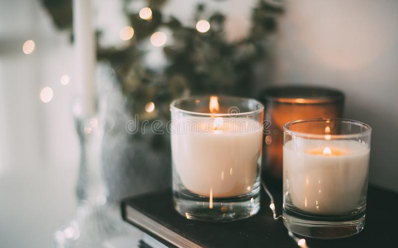 Cozy home interior decor, burning candles royalty free stock image