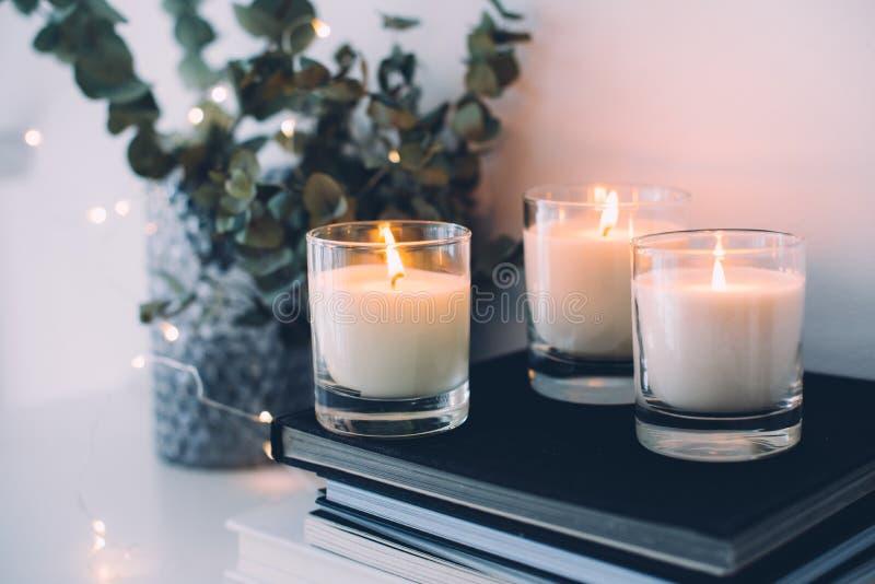 Cozy home interior decor, burning candles stock photo
