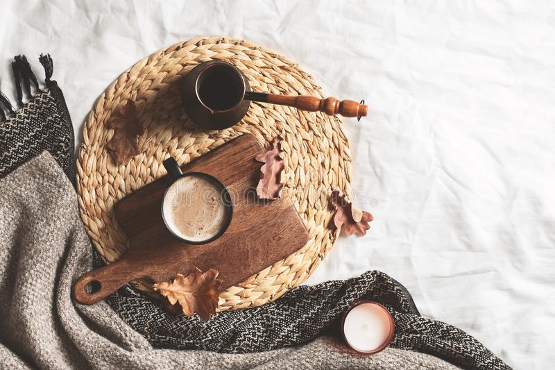 Cozy hygge autumn and winter coffee flat lay on bed royalty free stock image