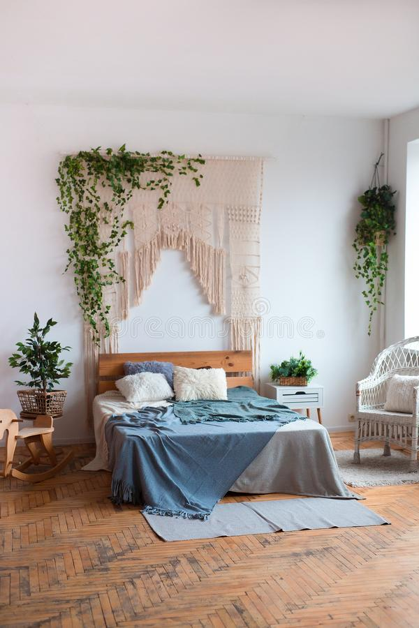 Cozy interior design of modern studio apartment in Scandinavian style. A spacious huge room in light colors with wooden royalty free stock image