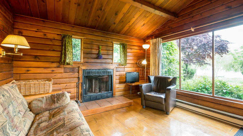 Cozy interior of a rustic log cabin stock images