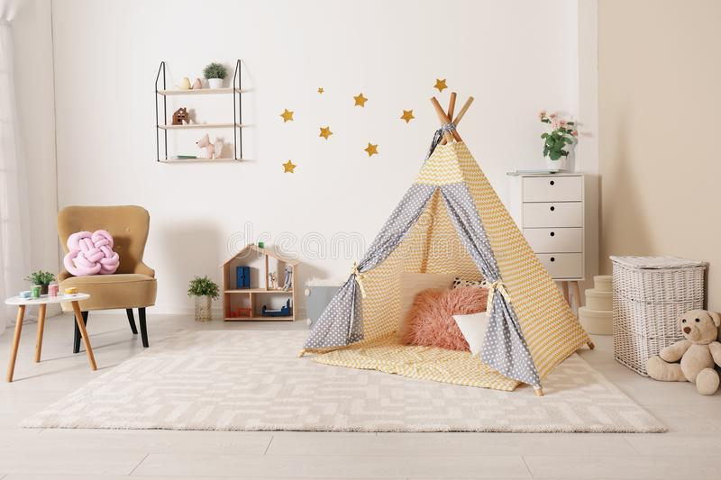 Cozy kids room interior with play tent royalty free stock images