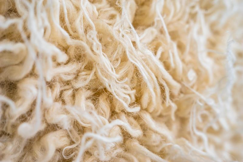 Cozy knitted wool closeup realistic macro photo. Knitted wool sweater closeup photo, raw, sheep, background, concept, softness, warmness, craft, crafts, curl stock photography