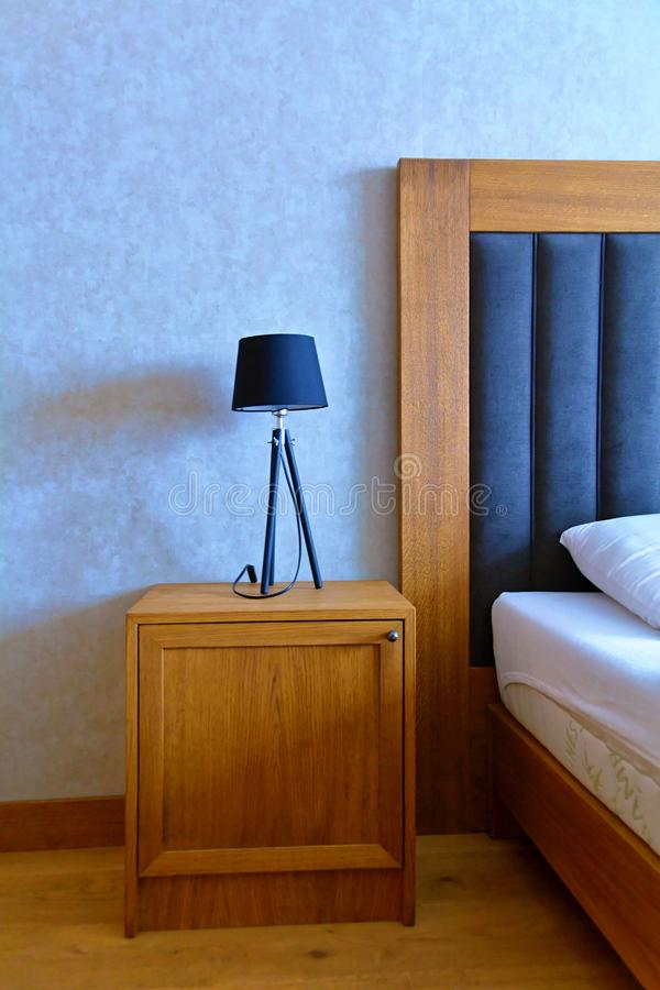 Luxury night stand with lamp stock photography