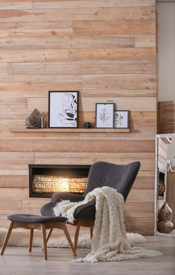 Cozy living room interior with comfortable furniture. And decorative fireplace royalty free stock photography