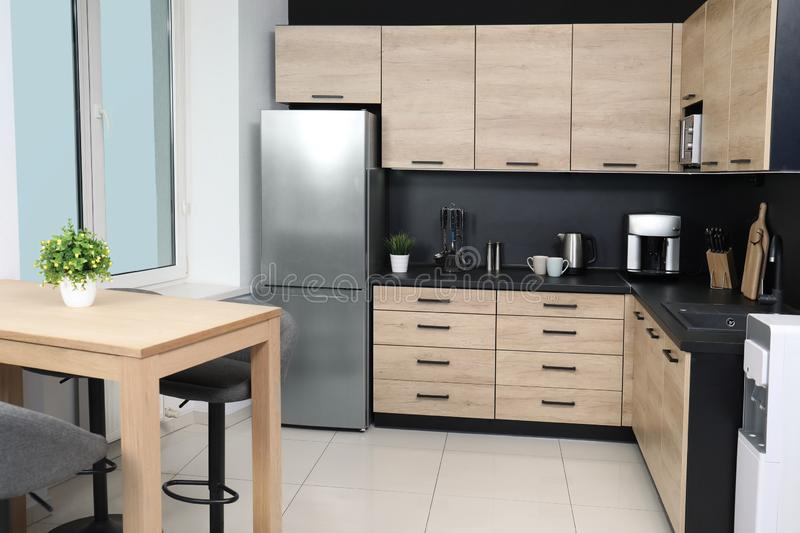 Modern kitchen interior with new furniture and appliances. Cozy modern kitchen interior with new furniture and appliances royalty free stock photo