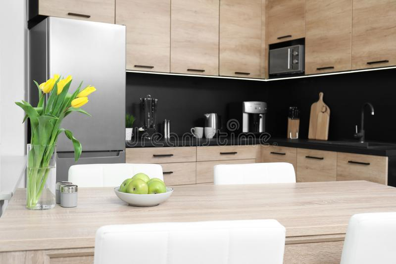 Cozy modern kitchen with new furniture and appliances. Cozy modern kitchen interior with new furniture and appliances stock photo