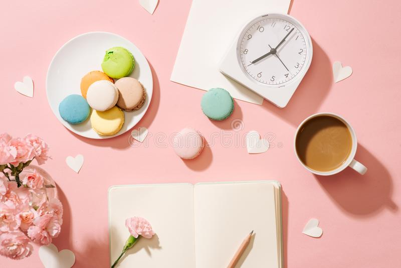 Cozy morning breakfast with pastel colorful macarons or macaroons. Cozy morning breakfast with pastel colorful macarons or macaroons stock photo