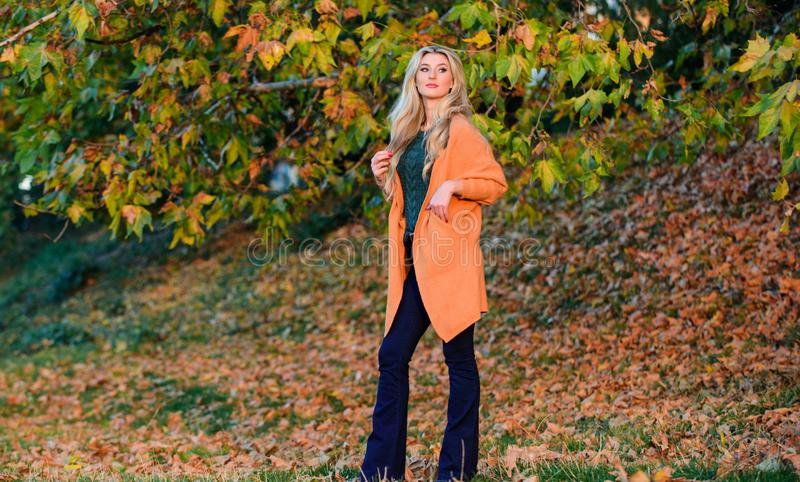 Cozy outfit ideas for weekend. Woman walk sunset time. Cozy casual outfits for late fall. Cozy and comfortable. Girl. Adorable blonde posing in warm and cozy stock photography