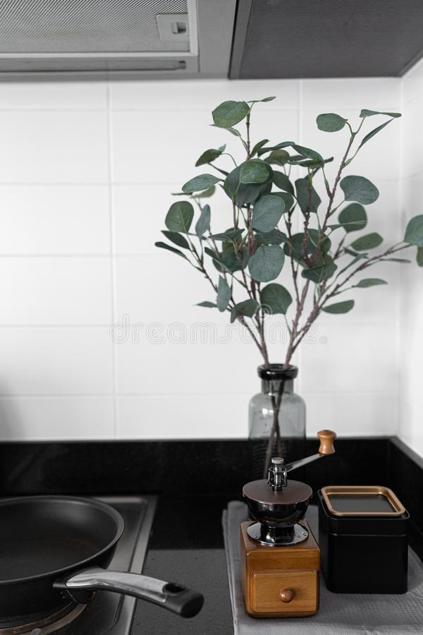 Cozy pantry corner / kitchen in scandinavian style white brick tile decoration and artificial plant in gray glass vase with hand c royalty free stock photo