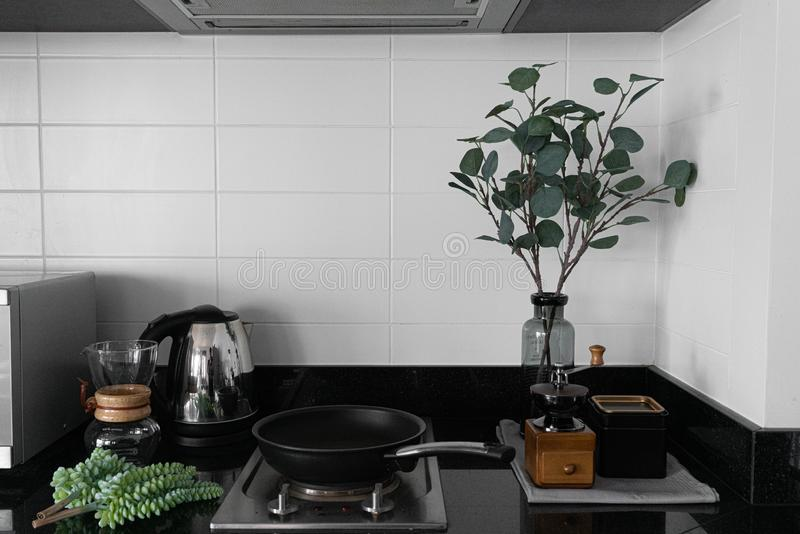 Cozy pantry corner / kitchen in scandinavian style white brick tile decoration and artificial plant in gray glass vase with hand c stock photos