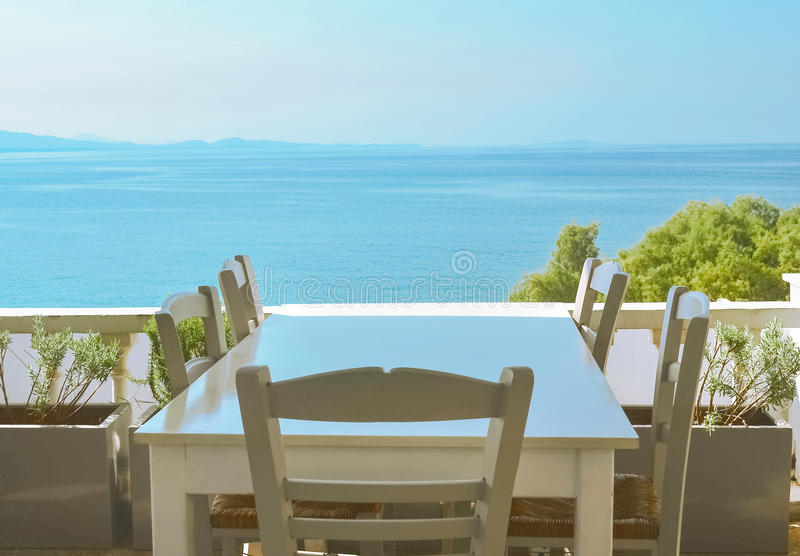 The restaurant on the Greek island. Ð¡ozy restaurant with a beautiful view of the sea royalty free stock photos
