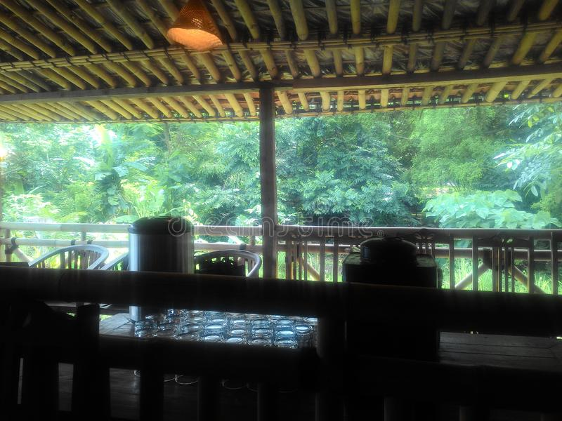 Cozy restaurant on the riverside. Just a village style restaurant in Ngaglik Sleman Indonesia royalty free stock image
