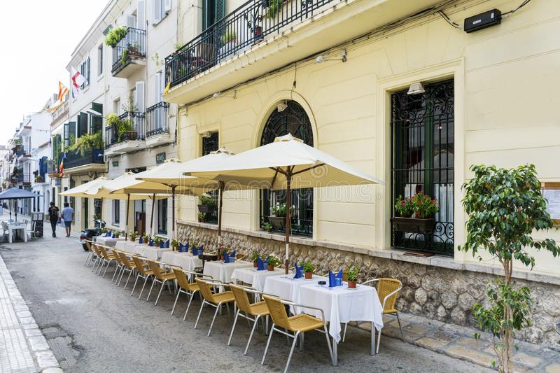 Outdoor restaurant in Barcelona. Cozy restaurant with tables and chairs stock photos