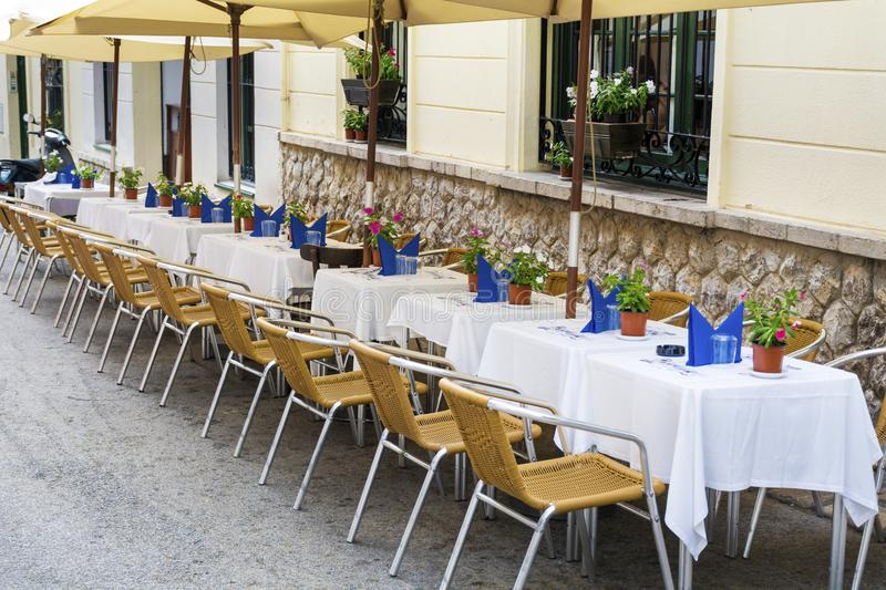 Outdoor restaurant in Barcelona. Cozy restaurant with tables and chairs royalty free stock photography