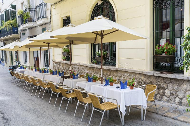 Outdoor restaurant in Barcelona. Cozy restaurant with tables and chairs stock photography