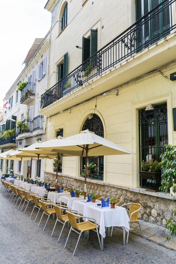 Outdoor restaurant in Barcelona. Cozy restaurant with tables and chairs royalty free stock images