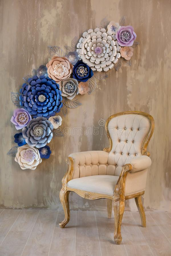 Cozy retro stylish home with decor inspired by designers and florist soul with royal colors. old fashion furniture chair in studio stock photo