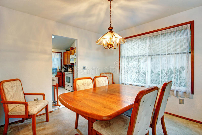 Cozy small dining room with window stock image