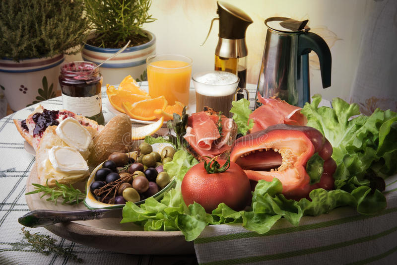 A cozy spanish breakfast in bright colors. Jamon tapas with cups of fresh hot coffee and orange juice. royalty free stock photos