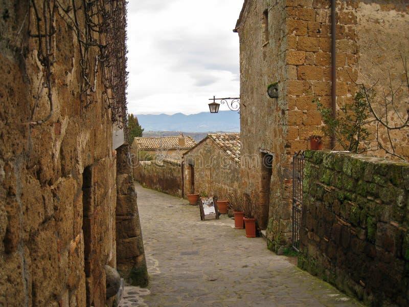 Cozy streets of the Italian city Civita-di-Bagnoredgio. In the mountains stock photo