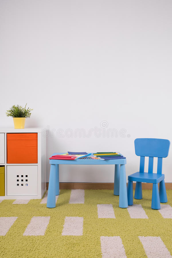 Cozy toddler's playroom. Small cute furniture in cozy toddler's playroom royalty free stock images