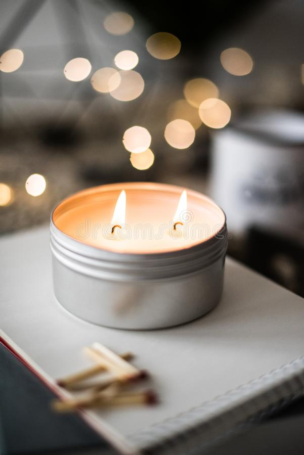 Cozy warm home decoration with burning candle and bokeh lights royalty free stock photos