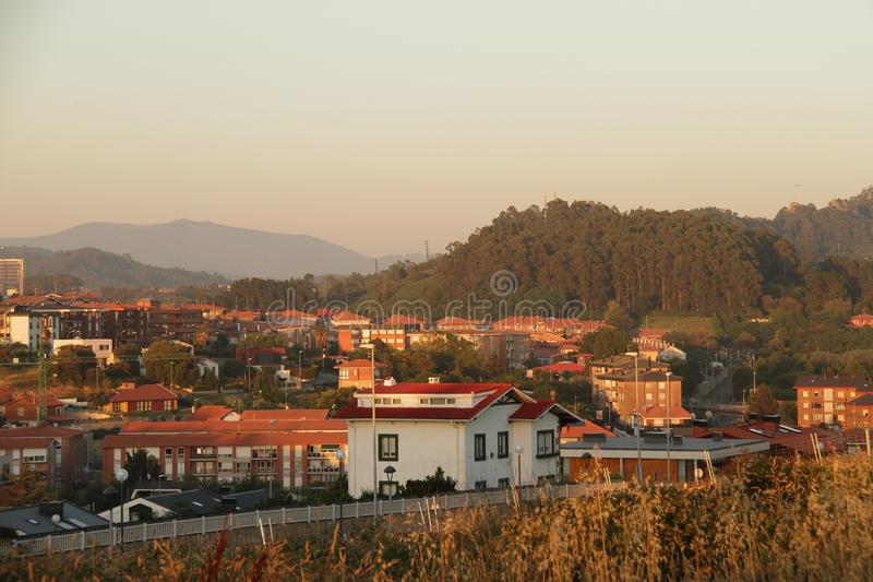 Cozy warm town Sopelana in Spain on sunset. Cozy sunny city Sopelana in Spain, Basque country, the way to the beach royalty free stock photos