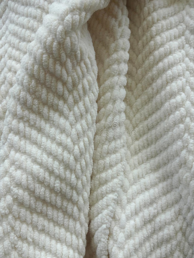 Cozy White Blanket. Comfy White Weave Heavy Throw Blanket royalty free stock photo