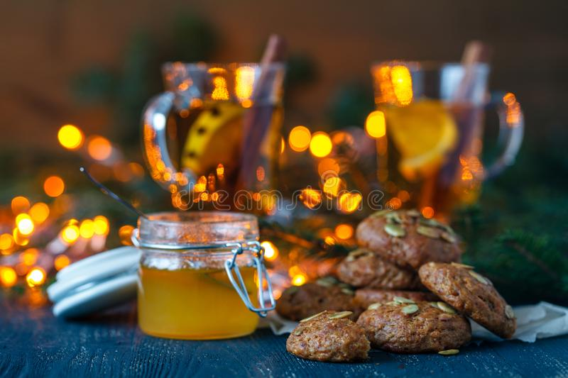 Cozy winter and Christmas setting with hot mulled wine with homemade cookies. Warm and homely stock photo