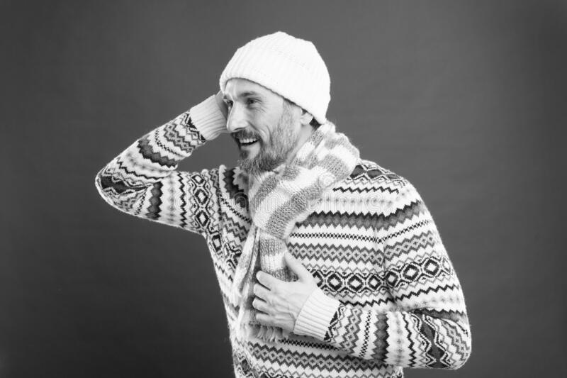 So cozy. Winter collection. Mature man enjoy warmth comfort. Cold winter conditions. Handsome bearded guy wearing hat royalty free stock image