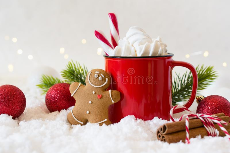 Cozy winter composition with a cup of hot chocolate with marshmallows gingerbread man cookies on a light background. Cozy winter composition with a cup of hot royalty free stock images