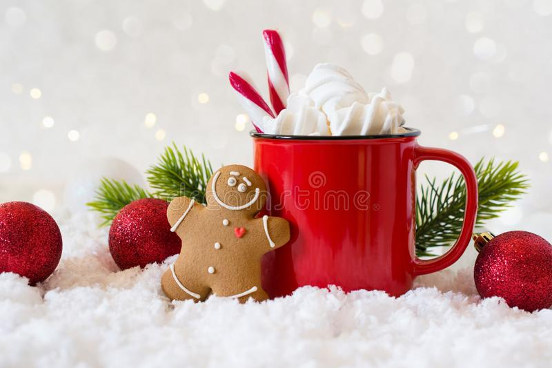 Cozy winter composition with a cup of hot chocolate with marshmallows gingerbread man cookies on a light background stock photos