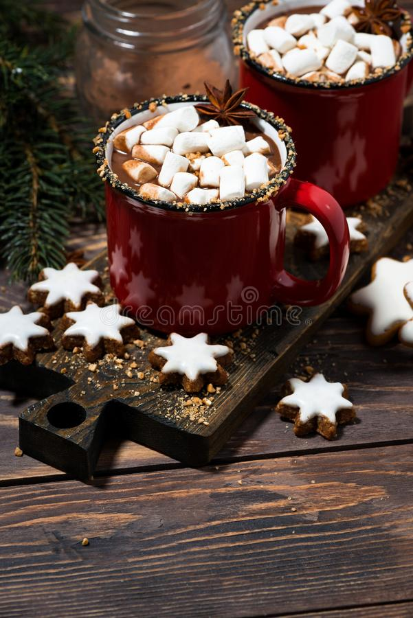 Cozy winter drink hot chocolate on a wooden table, vertical. Cozy winter drink hot chocolate on a wooden table, top view stock image
