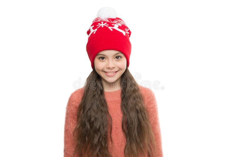 Cozy winter outfit. Little kid wear knitted hat. Stay warm this winter. Happy little girl winter fashion accessory. Small child smiling in fur hat white stock image