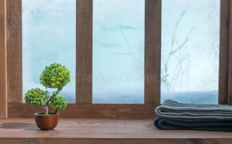 Cozy winter wooden window sill indoors home background. A cozy winter wooden window sill indoors home background stock photo