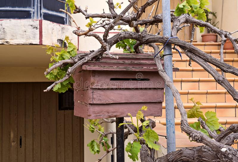 Cozy wooden mailbox outside for letter and newspapers royalty free stock photos