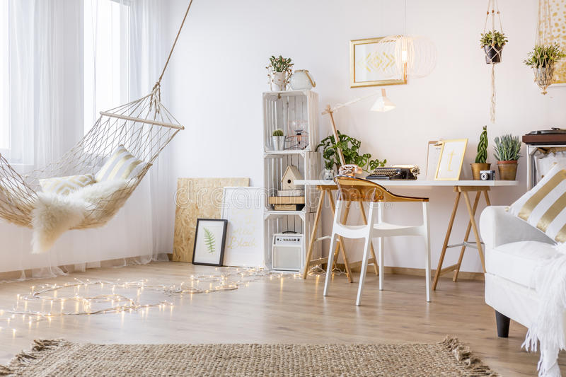 Cozy working place. In the white room with hammock stock photos