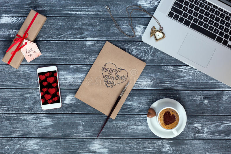 Cozy working Place on Wood Flat Lay on Valentines Day. Cozy working Place top View on Valentines Day with Business Gadgets Computer and Telephone Coffee Mug royalty free stock image