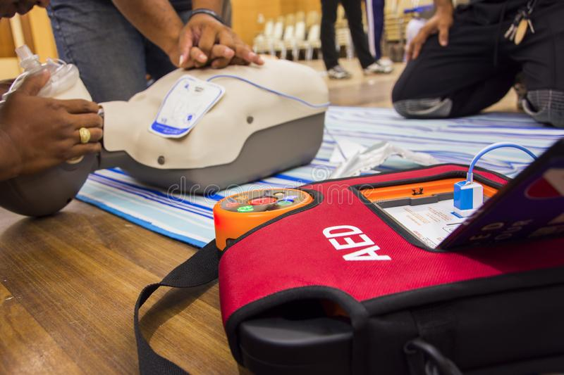 Cpr with aed training and blur background. Concept health care royalty free stock photography