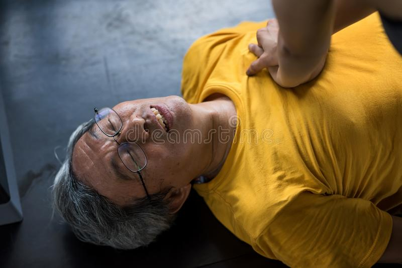 CPR to old man at gym stock image