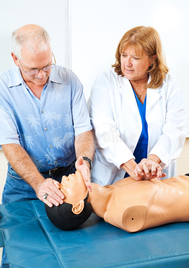 CPR de ensino dos primeiros socorros foto de stock royalty free