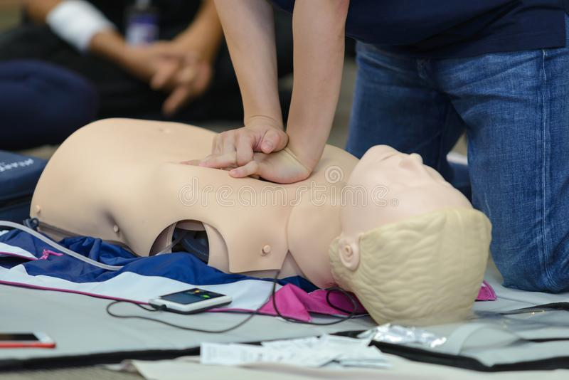 CPR First Aid Training with CPR dummy stock photos