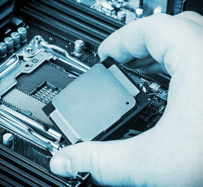 CPU在手中 库存图片