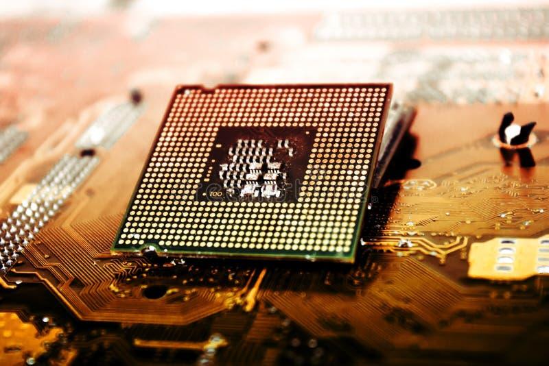 Cpu-Bewerker over Computermotherboard stock afbeelding