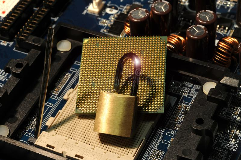 CPU Computer Processor over motherboard and padlock. Security Concept stock photo