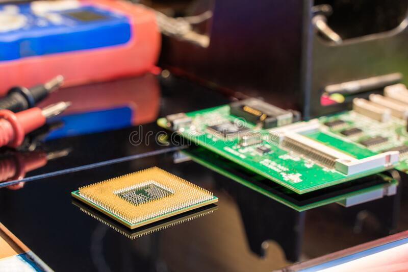CPU Processor Chip on Equipment Table Stock Photo royalty free stock photography
