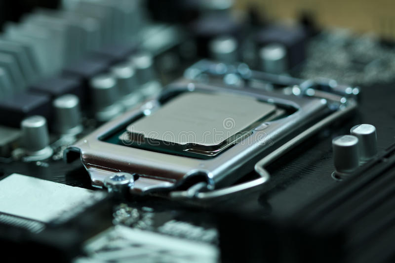 CPU Processor installed on a motherboard socket royalty free stock photos