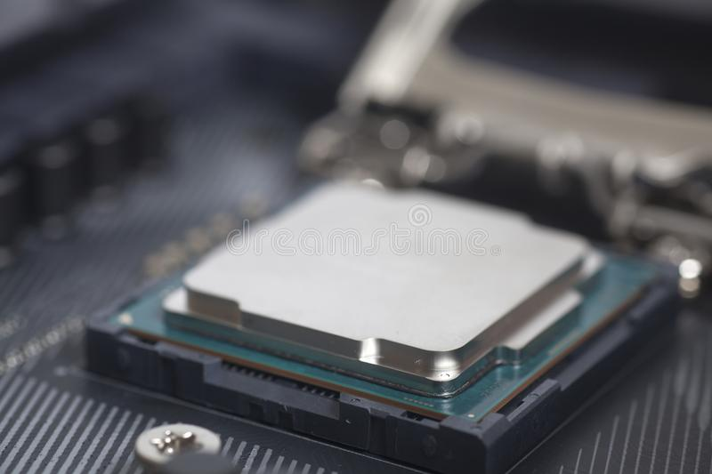 CPU in socket Intel LGA 1151 on motherboard Computer PC. Close up stock photography
